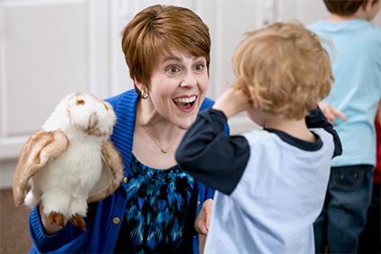 Toddler and Educator with Puppet