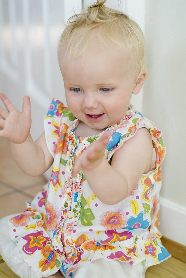 bigstock_Baby_Girl_Clapping_Hands_724132