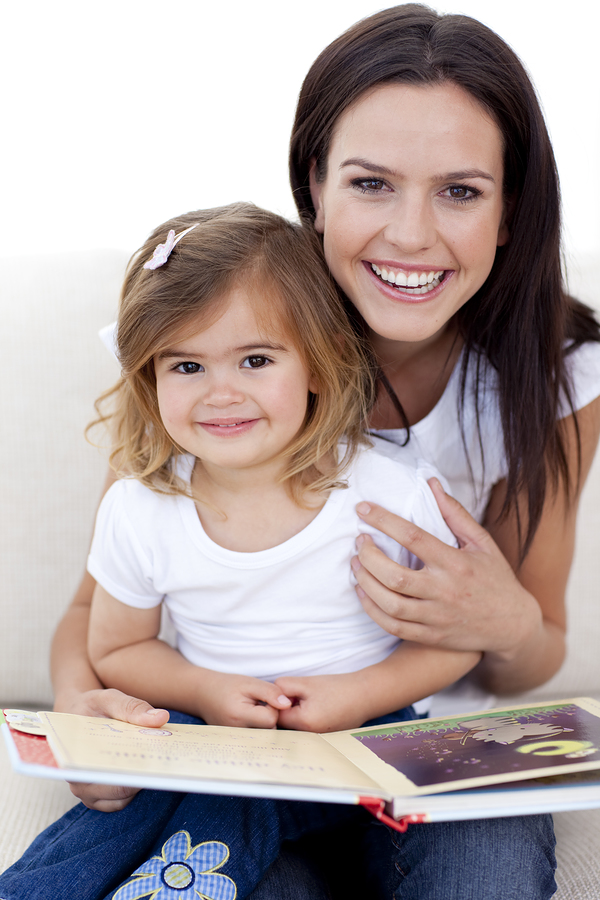 bigstockphoto_Smiling_Mother_And_Daughter_Re_6181129