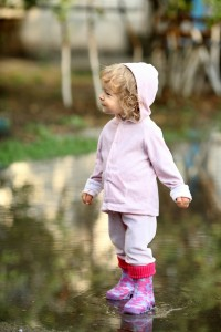 Cute child in puddle