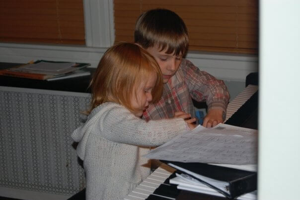 The author's children magically getting along while improvising at the piano.