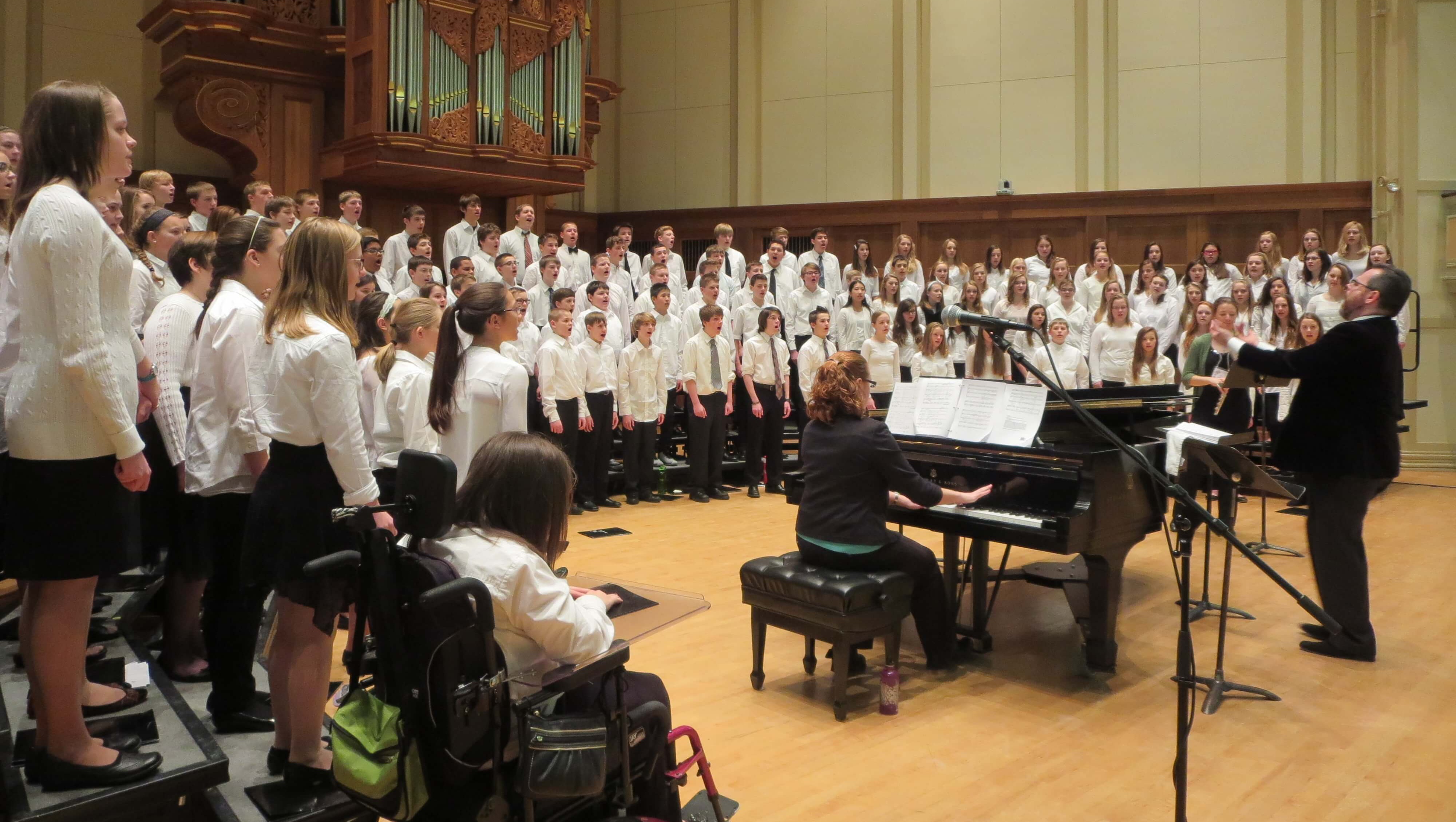 Dr. Boyle conducts the Middle Level All State Choir in Wisconsin. Scedra is right in the front row.