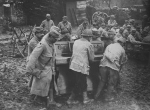 Soldiers moving a piano during World War I - 1916 - from the Archive of the Bibliothèque de Documentation internationale contemporaine, Paris.